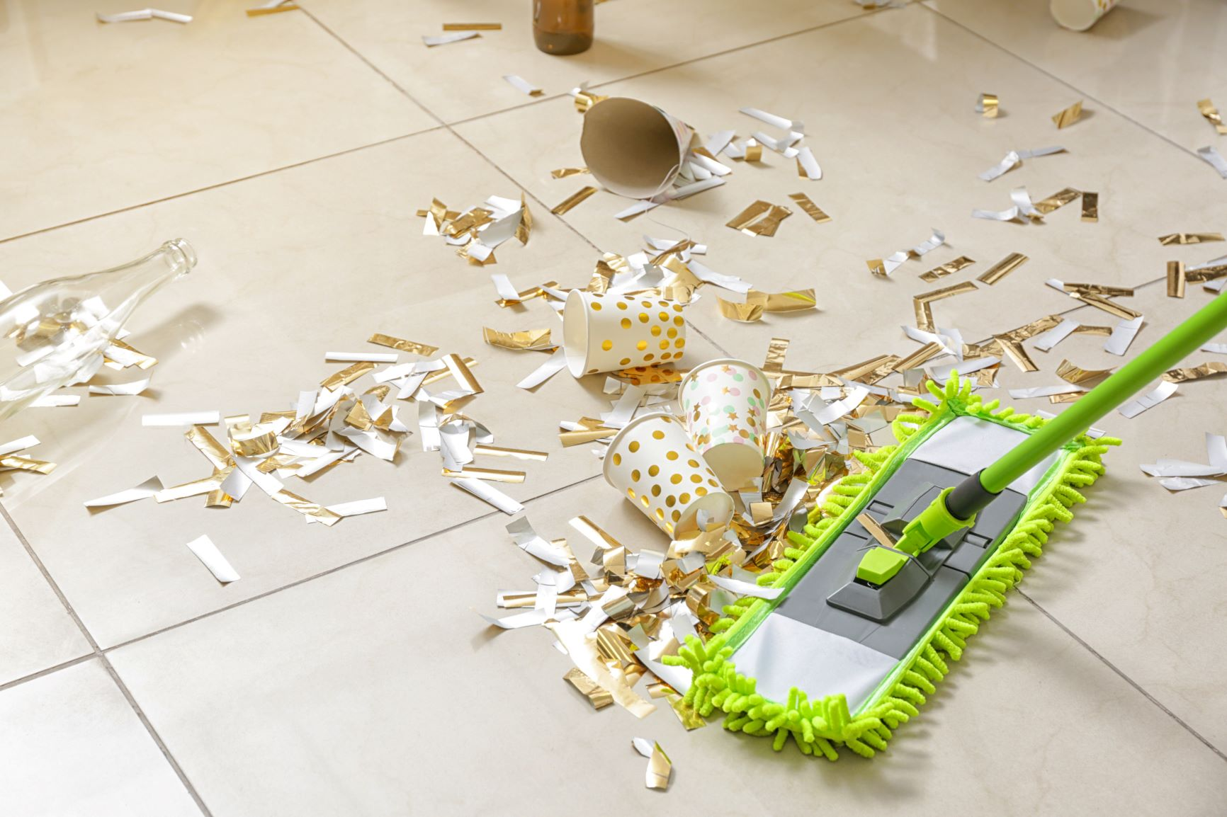 mopping up mess on floor after party